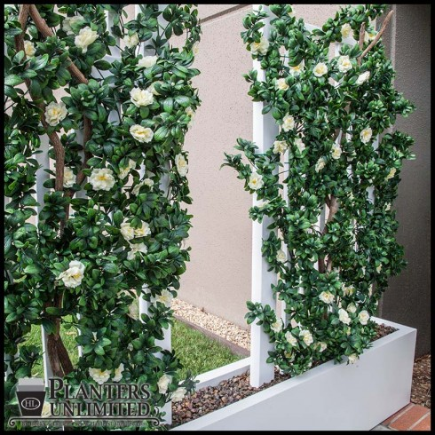 Artificial plants commercial planters a match made in for No maintenance outdoor plants