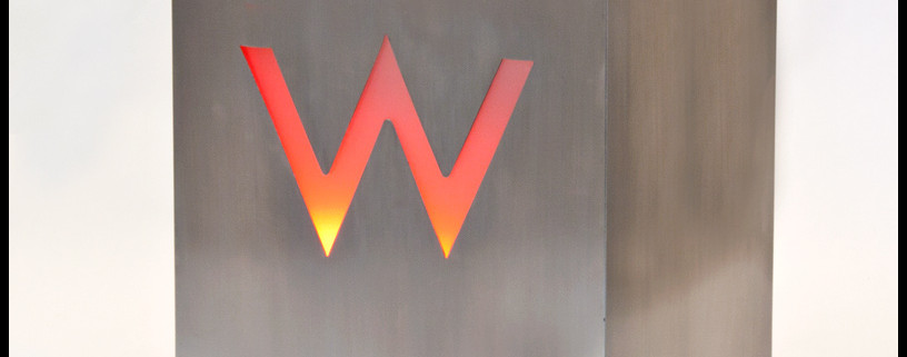 Imagine your business logo illuminated like this stainless steel planter designed for the W Hotel.